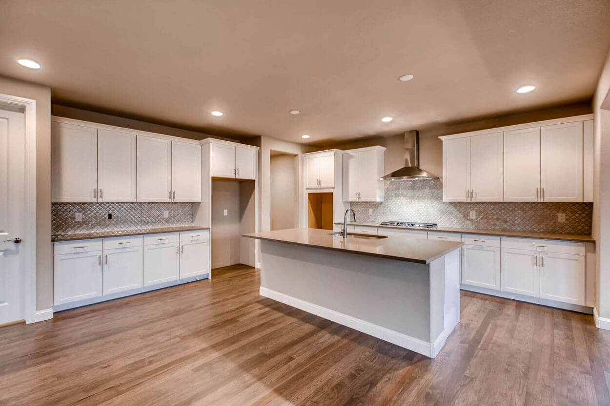 Kitchen Island and White Cabinets in Luxury Home Parker CO