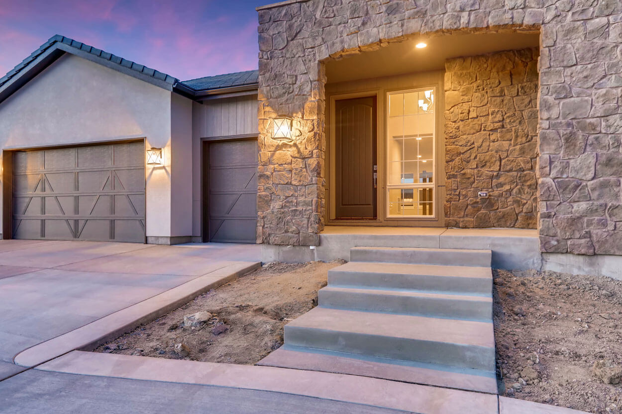 Front Door and Garage of Ranch Style Home