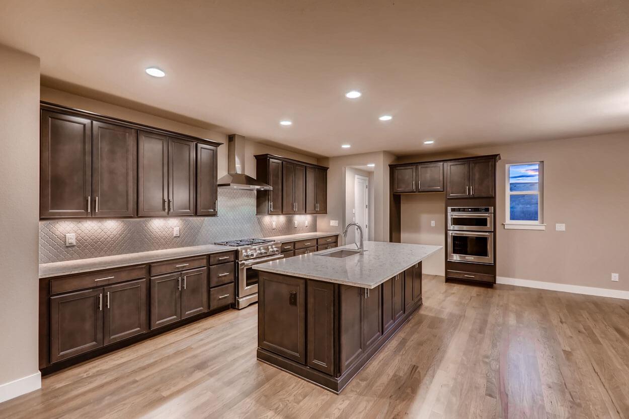 Big Kitchen Island and Brown Cabinets