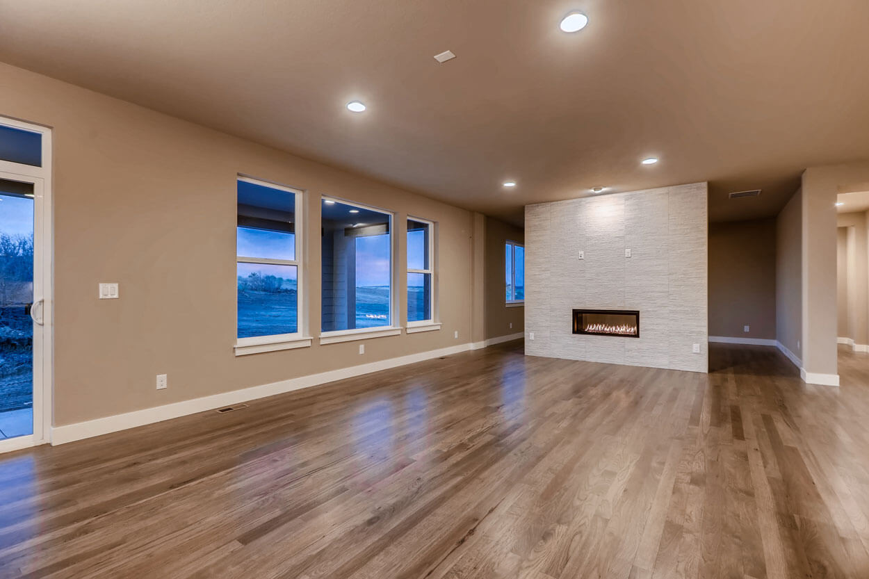 Great room with a fireplace in a ranch style home in Parker Colorado