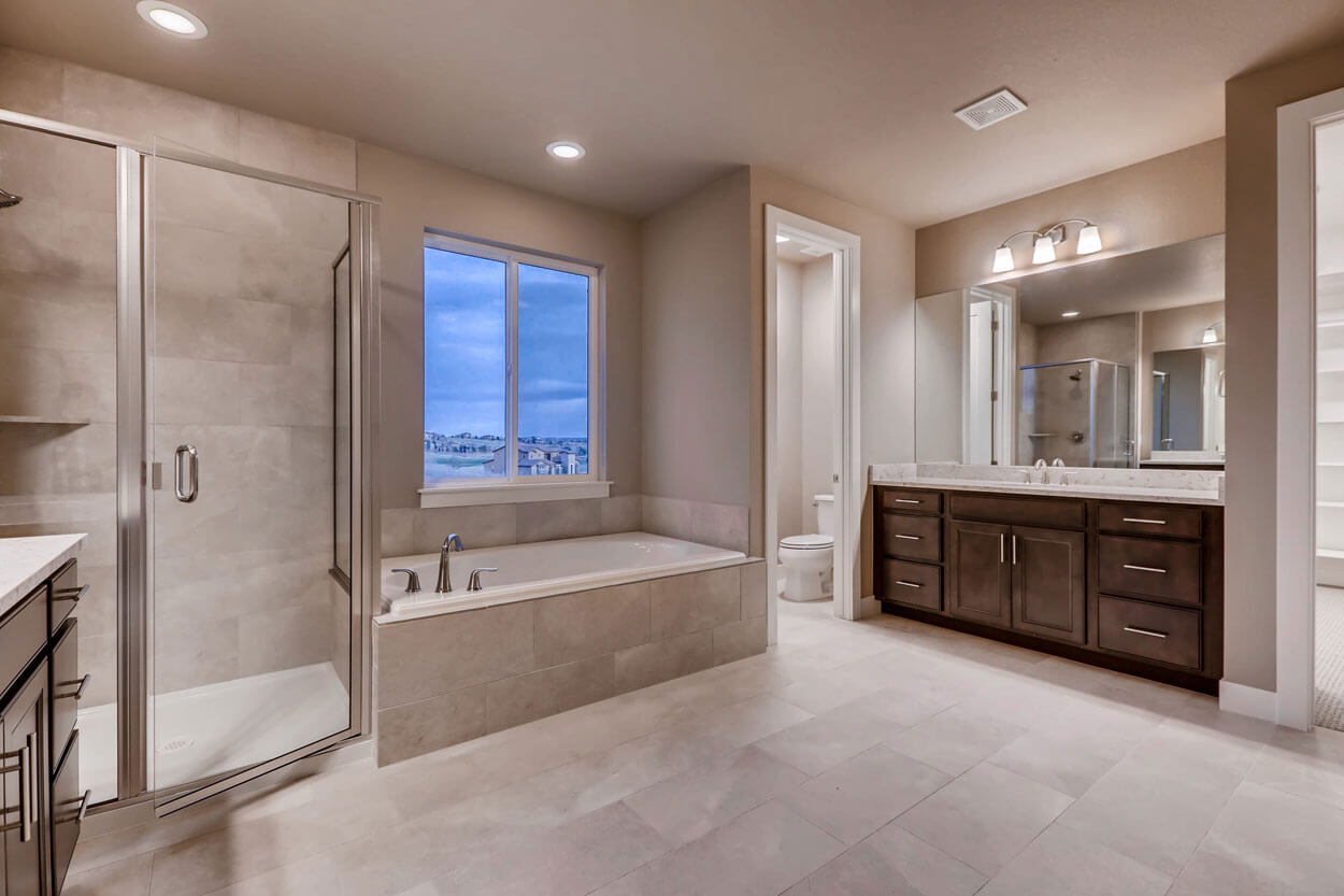 Toilet and Sink in Master bathroom in a ranch style home in Parker