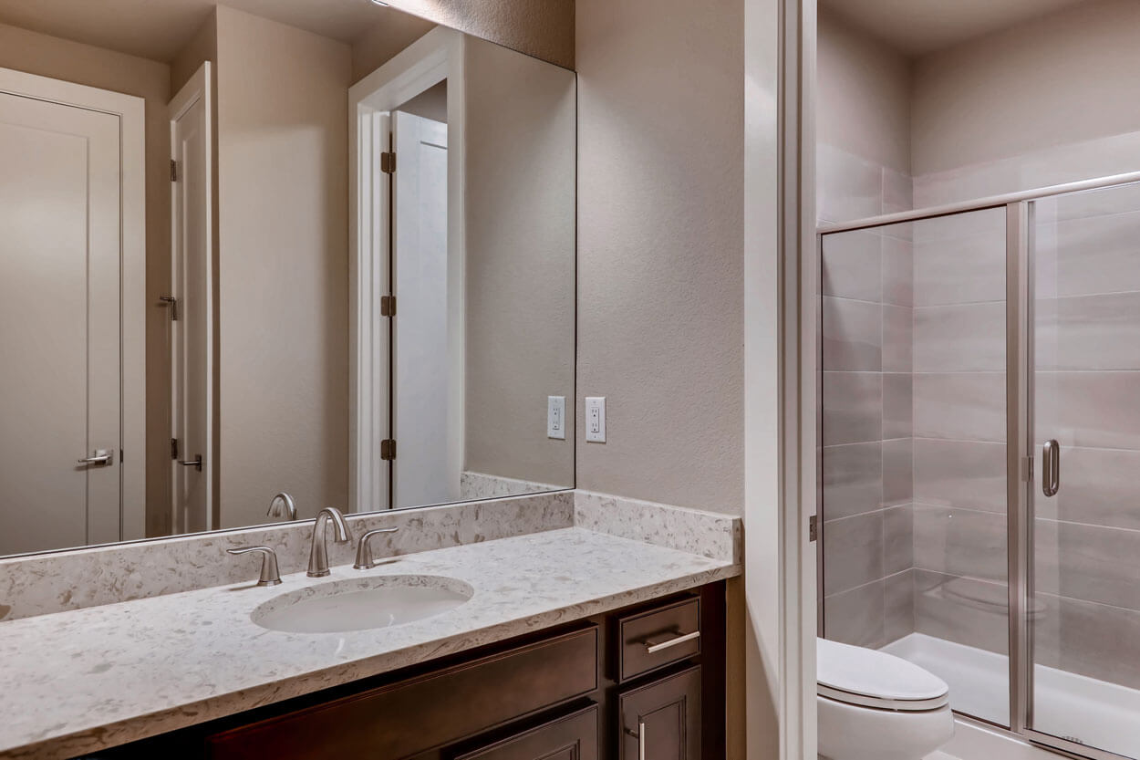 Mirror and Sink in the bathroom: 5608, Raintree Drive Parker