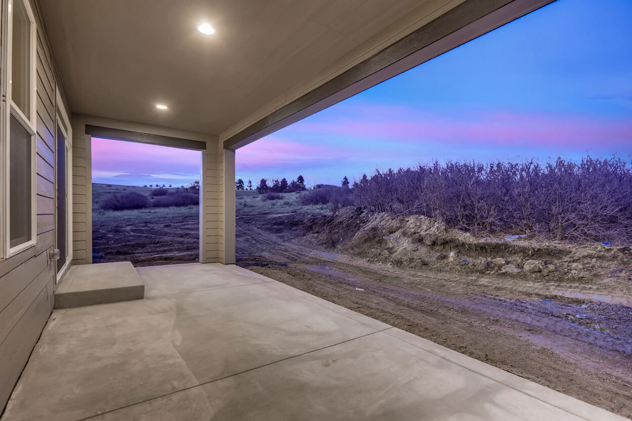 Patio and backyard view of 5608 Raintree Drive Parker